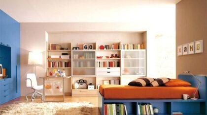 اتاق خواب نوجوان بهصورت مرتب و زیبا با تخت و کمد آبی